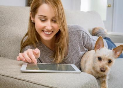 Dog owner on a tablet